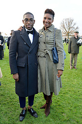 TINIE TEMPAH and DENISE LEWIS at the 2013 Hennessy Gold Cup at Newbury Racecourse, Berkshire on 30th November 2013.
