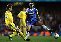 Photo: Paul Thomas.<br /> Chelsea v Levski Sofia. UEFA Champions League, Group A. 05/12/2006. <br /> <br /> Frank Lampard (R) of Chelsea tries to block the Elin Topuzakov pass.