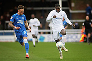 Coventry City forward Amadou Bakayoko and Peterborough Utd midfielder Ben White (6) during the EFL Sky Bet League 1 match between Peterborough United and Coventry City at London Road, Peterborough, England on 16 March 2019.