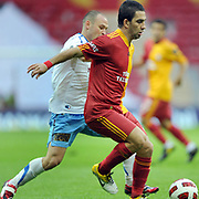 Galatasaray's Arda TURAN (R) during their Turkish superleague soccer derby match Galatasaray between Trabzonspor at the TT Arena in Istanbul Turkey on Sunday, 10 April 2011. Photo by TURKPIX