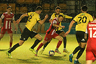 Matt Jay of Exeter takes on Harrogates Jake Lawlor and Joshua March during the EFL Sky Bet League 2 match between Harrogate Town and Exeter City at the EnviroVent Stadium, Harrogate, United Kingdom on 19 January 2021.