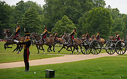 © Licensed to London News Pictures. 02/06/2015. London, UK. The King's Troop Royal Horse Artillery  ride their horses and gun carriages on to Hyde Park, before staging a 41 Gun Royal Salute in Hyde Park, London to mark the 62nd anniversary of the coronation of Queen Elizabeth II. Photo credit: Ben Cawthra/LNP
