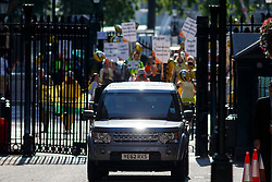 © Licensed to London News Pictures. 01/07/2014. LONDON, UK. Prime Minister David Cameron's car is seen with protesters in Downing Street ahead of a cabinet meeting on Tuesday, 1 July 2014. Photo credit: Tolga Akmen/LNP
