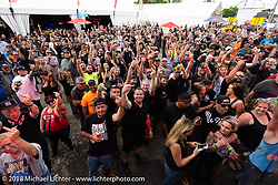 Crowd in front of the main stage at the wet-t shirt contest at the Laconia Roadhouse during Laconia Motorcycle Week. NH. USA. Wednesday June 13, 2018. Photography ©2018 Michael Lichter.
