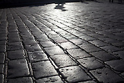 Cobblestone pavement at Hradcanske Namesti (Prague Castle Square) in front of the main entrance to the castle.