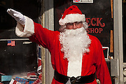 Santa Claus gives a Nazi salute outside the Redneck Shop December 5, 2009 in Laurens, SC during the 7th Annual White Unity Christmas Party held by the American Nazi Party & International Knights of the Ku Klux Klan.