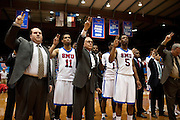 Head coach Larry Brown of the SMU Mustangs and his team stand for the school song after losing to the Memphis Tigers 52 - 60 at Moody Coliseum on Wednesday, February 6, 2013 in University Park, Texas. (Cooper Neill/The Dallas Morning News)