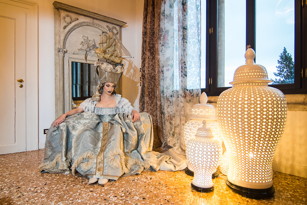"""Venice, February 2019<br /> Model Vanessa Busca wear a """"Veliero"""" dress, that is a court dress, Andrienne model, in Rubelli fabric. The wig is an interpretation in contemporary materials of the famous """"Pouf à la belle poule"""" hairstyle worn by Maria Antonietta to celebrate the French victory against the British in the Americas.<br /> The theme for the 2019 edition of Venice Carnival is 'Venice, the oldest city of the future!' and will run from 16th of February to 5th of March 2019."""