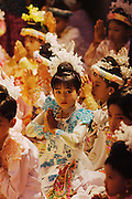 Young child in full traditional dress at novitation ceremony