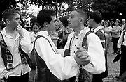 Two boys dance at the end of the March that roams the neighbourhood street one week before Liberdade Avenue's parade, Participants use precedent year's costumes and music.