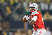 Cardale Jones #12 of the Ohio State Buckeyes drops back to pass against the Oregon Ducks during the College Football Playoff National Championship Game at AT&T Stadium on January 12, 2015 in Arlington, Texas.  (Cooper Neill for The New York Times)