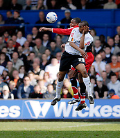 Photo: Leigh Quinnell.<br /> Luton Town v Southampton. Coca Cola Championship. 07/04/2007. Southamptons Pele jumps with Lutons Calvin Andrew.