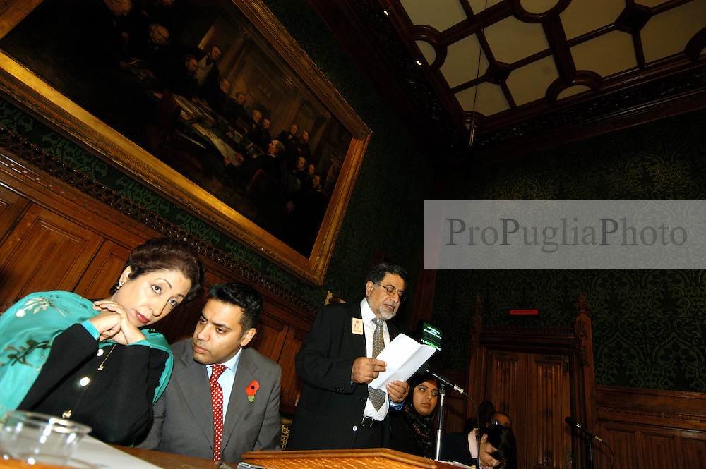 LONDON 9 Nov. 2005...Dr. Maleeha Lodhi and Shahid Malik MP confer. Professor Nazir Shawl of the Justice Foundation Kashmir Centre delivers his speech on their left....The Justice Foundation Kashmir Centre London together with the All-Party Parliamentary Group (APPG) on Kashmir organised a meeting in the House of Commons entitled ?Kashmir After the Earthquake ? Rebuilding Together.
