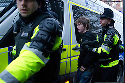 © under license to London News Pictures. 30/11/2010 A student is escorted to the correct side of the police line in Bristol today (Tuesday). Demonstrations all over the UK are taking place to protest against proposed higher education fees. Credit should read: David Hedges/LNP