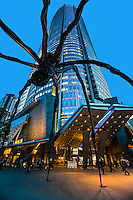 """Mori Tower """"Maman"""" Spider Sculpture - Constructed by building tycoon Minoru Mori, Roppongi Hills incorporates office space, apartments, shops, restaurants, cafés, movie theaters, a museum, a hotel, a TV studio, an outdoor amphitheater, and a park. The centerpiece is the 54-story Mori Tower with its famous spider sculpture """"Maman"""" by Louise Bourgeois."""