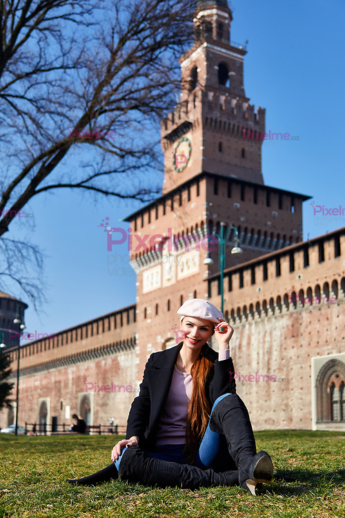 Girl sitting in front of Castelo Sforzesco smile for a portrait in Milano Italy