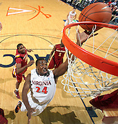 Dec. 30, 2010; Charlottesville, VA, USA; Virginia Cavaliers guard K.T. Harrell (24) shoots the ball in front of Iowa State Cyclones guard Bubu Palo (1) and Iowa State Cyclones forward Calvin Godfrey (15) during the game at the John Paul Jones Arena. Iowa State Cyclones won 60-47. Mandatory Credit: Andrew Shurtleff