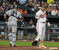 May 30, 2017 - Baltimore, MD, USA - The Baltimore Orioles' Manny Machado slams his batting helmet to the ground after striking out against the New York Yankees in the third inning at Oriole Park at Camden Yards in Baltimore on Tuesday, May 20, 2017. The Yankees won, 8-3. (Credit Image: © Kenneth K. Lam/TNS via ZUMA Wire)