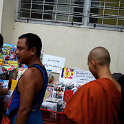May 19, 2013 - Yangon, Myanmar: A buddhist monk buys goods at a CD stand marked with a sticker emblazoned with 969, the logo that has come to represent Myanmar's anti-Muslim movement. Taxis, buses, shop fronts and street stalls across the country display what some consider a symbol of Buddhist<br />extremism that sees Burma's Muslim community as a threat to the country and its dominant religion. CREDIT: Paulo Nunes dos Santos