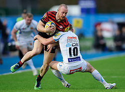 Saracens Winger (#14) James Short is tackled by Exeter Chiefs Fly-Half (#10) Gareth Steenson during the first half of the match - Photo mandatory by-line: Rogan Thomson/JMP - Tel: Mobile: 07966 386802 16/02/2013 - SPORT - RUGBY - Allianz Park - Barnet. Saracens v Exeter Chiefs - Aviva Premiership. This is the first Premiership match at Saracens new home ground, Allianz Park, and the first time Premiership Rugby has been played on an artificial turf pitch.