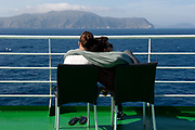 Passengers are seen on the Grimaldi Lines Cruise Barcelona, near the Corsica area during the Barcelona-Civitavecchia trip, in France, on Tuesday, June 11, 2013.  Photographer: Víctor Sokolowicz/Bloomberg.