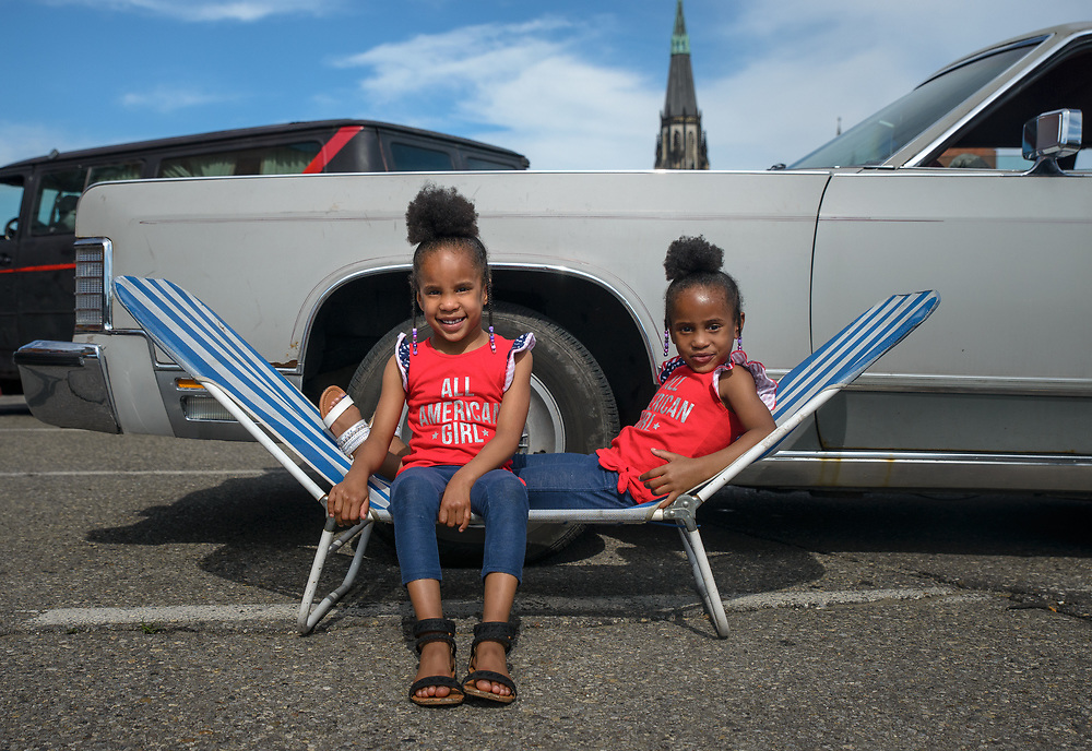 Mariah and Myah Molborough pose for a portrait during their cookout before the Ford Fireworks at Eastern Market in Detroit, Michigan on June 25 2018.<br /> <br /> Credit: Cameron Pollack / Detroit Free Press