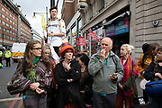 Climate change activists from the Extinction Rebellion group sing songs as police begin talking to and trying to clear Oxford Street near to the Marble Arch camp in protest that the government is not doing enough to avoid catastrophic climate change and to demand the government take radical action to save the planet, on 24th April 2019 in London, England, United Kingdom. Extinction Rebellion is a climate change group started in 2018 and has gained a huge following of people committed to peaceful protests.