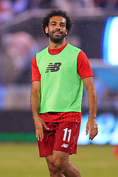 July 25, 2018 - East Rutherford, NJ, U.S. - EAST RUTHERFORD, NJ - JULY 25:  Liverpool midfielder Mohamed Salah (11) warms up during halftime of the International Champions Cup Soccer game between Liverpool and Manchester City on July 25, 2018 at Met Life Stadium in East Rutherford, NJ.  (Photo by Rich Graessle/Icon Sportswire) (Credit Image: © Rich Graessle/Icon SMI via ZUMA Press)