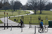As the second week of the UK governments Coronavirus lockdown ends on a fine Spring weekend, and 24hrs after it was reported that 3,000 Londoners had been counted in Brockwell Park, Herne Hill, resulting in the closure of this significant public green space by Lambeth council, the piblic stand at the closed gates See a similar view with many people 2 days before in Getty image #1209106121, on 5th April 2020, in London, England.