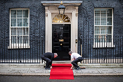 © Licensed to London News Pictures. 01/03/2017. London, UK. The red carpet is laid down outside No 10 Downing Street before British Prime Minister Theresa May receives King Abdullah II of Jordan. Photo credit: Rob Pinney/LNP