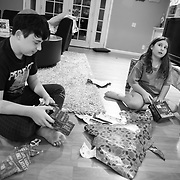 Erin celebrates the first night of Chanukah with her children at home. After dinner, lighting the Menorah and reciting a prayer, the kids opened gifts. It's been a hard year for both kids, especially Brooklyn who days earlier had to suddently deal with her dog Rosie being put to sleep.