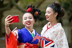 "© Licensed to London News Pictures. 29/09/2019. London, UK. Performers wearing Japanese outfits take a selfie during the annual Japan Matsuri festival of Japanese music, food and culture in Trafalgar Square. The concept of the theme this year is ""Future generations"".<br /> <br /> Photo credit: Dinendra Haria/LNP"
