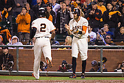 San Francisco Giants right fielder Hunter Pence (8)  celebrates center fielder Denard Span (2) scoring a run against the Chicago Cubs in Game 3 of the NLDS at AT&T Park in San Francisco, Calif., on October 10, 2016. (Stan Olszewski/Special to S.F. Examiner)