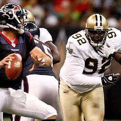 August 21, 2010; New Orleans, LA, USA; New Orleans Saints defensive tackle Remi Ayodele (92) pressures Houston Texans quarterback Matt Schaub (8)during the first quarter of a preseason game at the Louisiana Superdome. Mandatory Credit: Derick E. Hingle