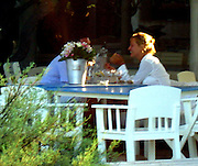 """**EXCLUSIVE**<br />Uma Thurman and boyfriend Andre Balazs <br />After sharing a bottle of rose wine, laughing and kissing each other at Club 55 Restaurant, he even asked the waiter if she could take the flower arrangement from the table; Uma Thurman and boyfriend Andre Balazs begged a taxi driver to take them, but the taxi was waiting for another customer.<br />Not happy about the situation they go back inside the restaurant, Uma sits on the floor start slamming her shoes saying """"I am not happy about this, this ruining my day""""<br />Club 55 Restaurant<br />St. Tropez, France<br />Saturday, July, 24, 2004<br />Photo By Celebrityvibe.com/Photovibe.com, New York, USA, Phone 212 410 5354, email:sales@celebrityvibe.com"""