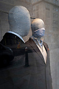 As the UK government tells the nation to prepare for the worst two weeks of the Coronavirus pandemic, a warning aimed at the population to stay at home and minimise contact with others, but in the week when new vaccination centres are opening, a masked mannquin looks out from the window of a menswear retailer, on 11th January 2021, in the City of London, England.