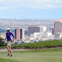 051214       Adron Gardner<br /> <br /> Downtown Albuquerque backdrops Tristin Goodwin at the University of New Mexico Championship Golf Course in Albuquerque Monday.