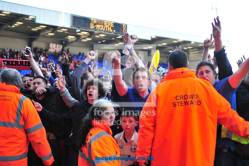 Picture by Ste Jones/Focus Images Ltd +44 7706 592282.27/04/2013.Bournemouth fans await the news to filter through to see if they are champions during the npower League 1 match at Prenton Park, Birkenhead.
