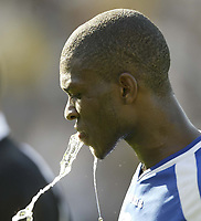 Photo: Aidan Ellis.<br /> Preston North End v Cardiff City. Coca Cola Championship. 09/09/2006.<br /> Cardiff's Kerrea Gilbert trys to cool himself down.