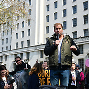 Speaker Dan Richardson is an actor rally at the 5th Global March for Elephants and Rhinos march against extinction and trophy hunting murdering and killing animals for blood spots and ivory trade outside downing street on 13 April 2019, London, UK.