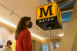 "© Licensed to London News Pictures. 20/10/2020. LONDON, UK.  London, UK.  20 October 2020. Staff members view ""Reconstructed Metro Cube"", 2019, by Margaret Calvert.  Preview of Margaret Calvert: Woman at Work at the Design Museum in Kensington.  The exhibition explores the graphic designer's influence on the UK's visual identity and continuing impact through projects such as the new Rail Alphabet 2 typeface for Network Rail.  Photo credit: Stephen Chung/LNP"