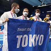 TOKYO, JAPAN - AUGUST 1:  Ryan Murphy, Michael Andrew, Caeleb Dressel and Zach Apple of the United States with a T'hank you Tokyo' sign after receiving their  gold medals after their 4x 100m medley relay for men victory at the Swimming Finals at the Tokyo Aquatic Centre at the Tokyo 2020 Summer Olympic Games on August 1, 2021 in Tokyo, Japan. (Photo by Tim Clayton/Corbis via Getty Images)