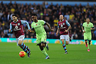 Raheem Sterling of Manchester city goes past Carles Gil of Aston Villa (l). Barclays Premier league match, Aston Villa v Manchester city at Villa Park in Birmingham, Midlands  on Sunday 8th November 2015.<br /> pic by  Andrew Orchard, Andrew Orchard sports photography.