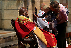Friday 7th October 2016.<br /> St. George's Cathedral,<br /> Cape Town,<br /> Western Cape,<br /> South Africa.<br /> <br /> Archbishop Emeritus Desmond Tutu Celebrates His 85th Birthday!<br /> <br /> Young fan Jesse-Sean Wessels (14 months) wishes Desmond Tutu Happy Birthday with a High Five during the morning service as his Mom Tamlyn Wessels watches the moment happen.<br /> <br /> Archbishop Emeritus and Nobel Peace Prize Laureate Desmond Tutu celebrates his 85th birthday along with special family, friends, guests, visitors and media during the Friday Mass held at St. George's Cathedral in Cape Town, South Africa on Friday 7th October 2016.<br /> <br /> Picture By:  Mark Wessels / RealTime Images.