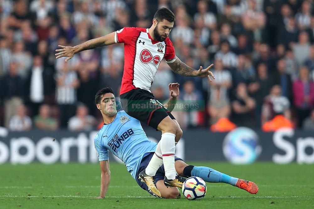 15 October 2017 - Premier League Football - Southampton v Newcastle United - Mikel Merino of Newcastle slide tackles Charlie Austin of Southampton - Photo: Charlotte Wilson / Offside