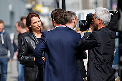 © Licensed to London News Pictures. 08/04/2015. LONDON, UK. A Hatton Garden burglary victim talking to media outside Hatton Garden Safety Deposit Ltd in London on Wednesday, 8 April 2015. Police believes that approximately 60 - 70 safety deposit boxes were opened during the burglary over Easter weekend. Photo credit : Tolga Akmen/LNP