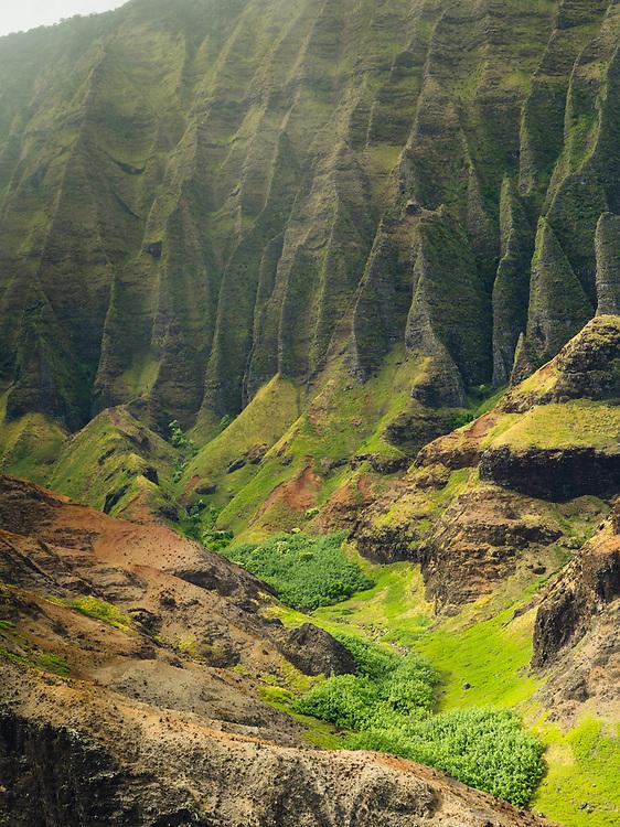 Aerial view of Kalalau Valley and the Na Pali coast, Kauai, Hawaii on a cloudy day.