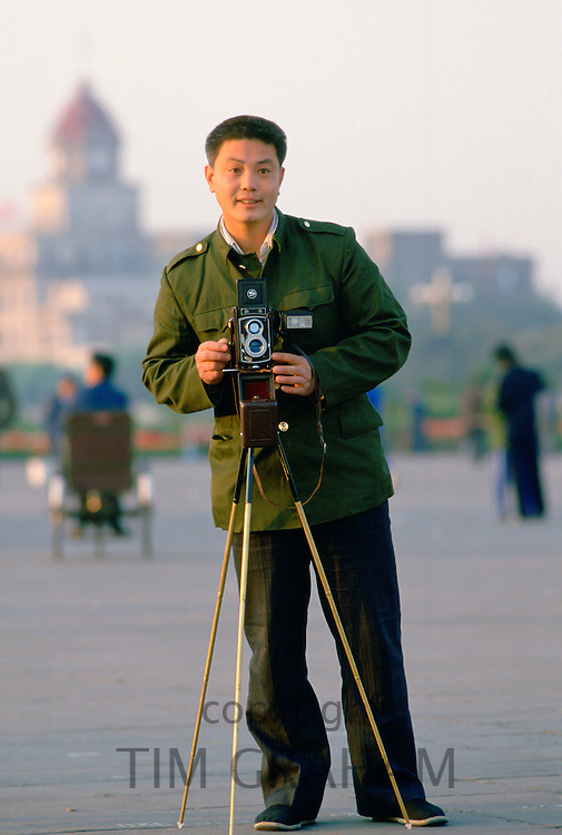 Official tourist photographer Tianenmen Square, Peking (Beijing), China