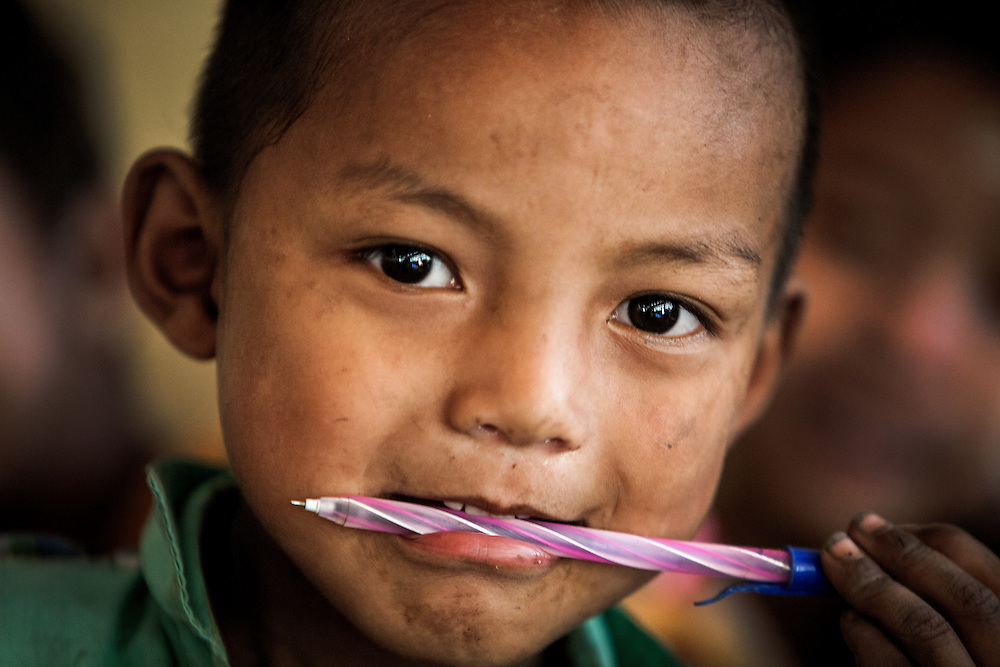 A boy at a small school in a Chin village near Mrauk U poses for a portrait.