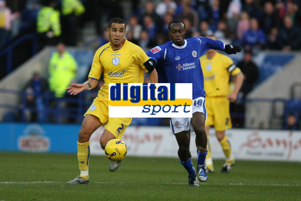 Photo: Pete Lorence.<br />Leicester City v Sheffield Wednesday. Coca Cola Championship. 02/12/2006.<br />Madjid Bougherra and Evlis Hammond battle for the ball.